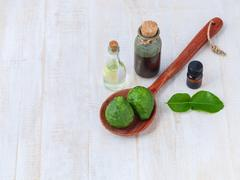 Natural Spa Ingredients . - Kaffir lime essential oil  for aromatherapy. Stock Photos