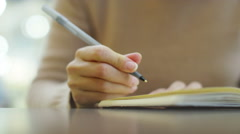 4k, Attractive, young woman writing in her diary at a train station - stock footage