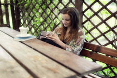 Woman sitting in the arbour and using smartphone Stock Footage