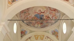Steadicam pan up to reveal a very old fresco in an Italian chapel with Canon 1Dc Stock Footage
