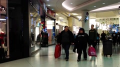 One side of people shopping inside Burnaby shopping mall - stock footage