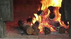 Closeup of logs burning in an old Italian pizza oven with Canon 1Dc Stock Footage
