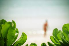 Blurred of bikini girl at tropical beach on summer . - stock photo