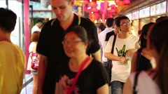 People on the Wangfujing snack street in Beijing, China Stock Footage