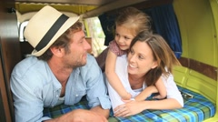 Portrait of cheerful family having fun in camper van - stock footage