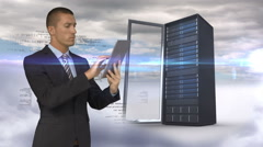 Businessman using tablet computer in front of server tower on sky background - stock footage