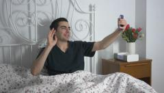4K Taking Selfies Young Man In Bed Funny - stock footage