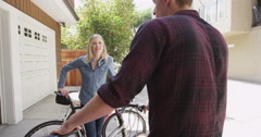 Couple talking outside with their bikes Stock Footage