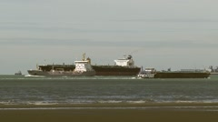 Shipping on the Western Scheldt + zoom out. Vlissingen skyline in background Stock Footage