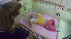 Mother feed baby with bottle lying in bed. 4K Stock Footage