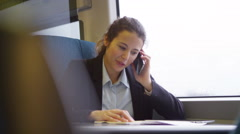 4k, Confident businesswoman on mobile phone on a train - stock footage