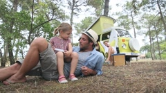 Daddy with little girl playing together on campground Stock Footage