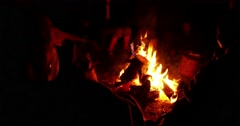 People Sitting By Campfire 4k Stock Footage