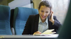 4k, Confident businesswoman on mobile phone on a train Stock Footage