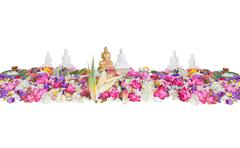 Ceremonial flowers and buddha figurines Stock Photos