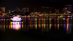 Da Nang - May 2015: Night city view with glowing lotus flower on river. 4K Stock Footage