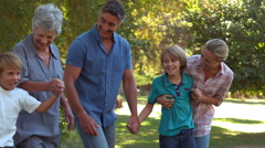 Happy family in the park - stock footage