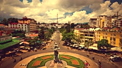Da Lat - May 2015: Retro look city view with roundabout traffic. 4K  time lapse. Stock Footage