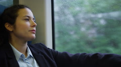 4k, tired, young businesswoman resting on commuter train returning from work Stock Footage