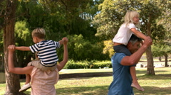 Happy family in the park together Stock Footage