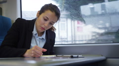 4k, Overworked businesswoman working on train on her way to a meeting - stock footage