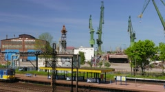 Train station in Gdansk, Poland. Gdansk shipyard in the background Stock Footage