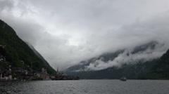 Deep heavy clouds on mountain lake Hallstatt Austria alps Stock Footage
