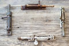 old metal latch for the door on wooden table. Copy space to right. - stock photo