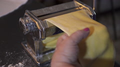 Making fresh pasta with a traditional style pasta machine. 4K UHD. Stock Footage