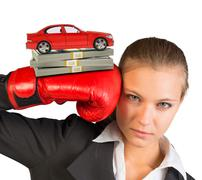 Businesswoman in boxing gloves - stock photo