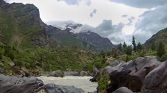 Time Lapse of Clouds over a Himalayan Mountain and River Stock Footage