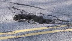 Pothole closeup Stock Footage