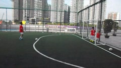 Shenzhen, China: children play football Stock Footage