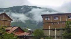 Time Lapse of Clouds over the Mountains in Manali India Stock Footage