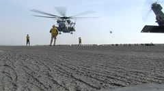 US Navy Helicopter Lands On Aircraft Carrier Deck Stock Footage