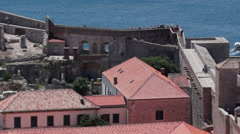 Tourists explore walls around the city of Dubrovnik Croatia Stock Footage