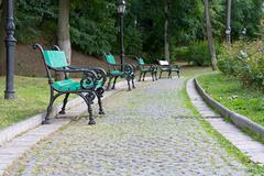 Stock Photo of Park walkway of paving stones and benches.