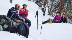 Tourists staged a small halt on the forest path during snowfall Stock Footage