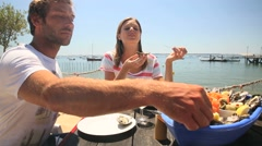 Couple at seafood outdoors restaurant tasting fresh oysters Stock Footage