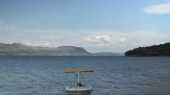 Croatia, view of bay in Lumbarda on Korcula Island with two swimmers in distance Stock Footage