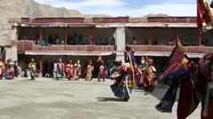 Buddhist Monks Performing Mask Dance at a Buddhist Monastery Stock Footage