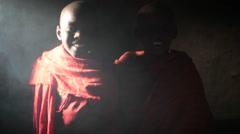 2 African tribal village children in smoky house, medium shot, lens flare Stock Footage