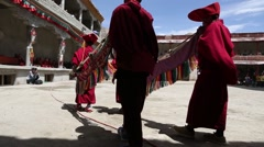 Buddhist Horn Players with Monks Performing Mask Dance at a Buddhist Monastery Stock Footage
