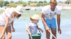 Family practicing recreational beach fisheries - stock footage