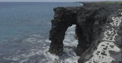 Ocean Arch Crashing Waves, Kilauea Volcano, Big Island, Hawaii, Red Camera - stock footage