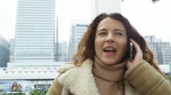 4k Young female tourist talking on her smartphone in the city. Stock Footage