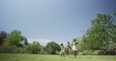 Young women running past camera Stock Footage