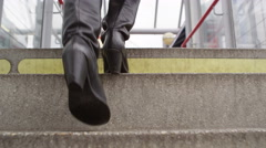 4k Attractive woman walking up steps to a train station or bus station Stock Footage