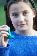 Girl Using Inhaler To Treat Asthma Attack Stock Photos