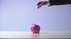 Coins thrown on a piggy bank, Sweden. Stock Footage